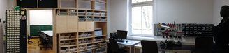 work area, with shelves, electronics storage shelves, and electronics working area (soldering iron etc)