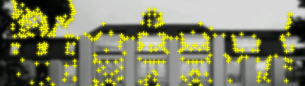 Image target with yellow crosses of the image of the bauhaus main building. It displays a contrast based features of the image that are visible to camera.
