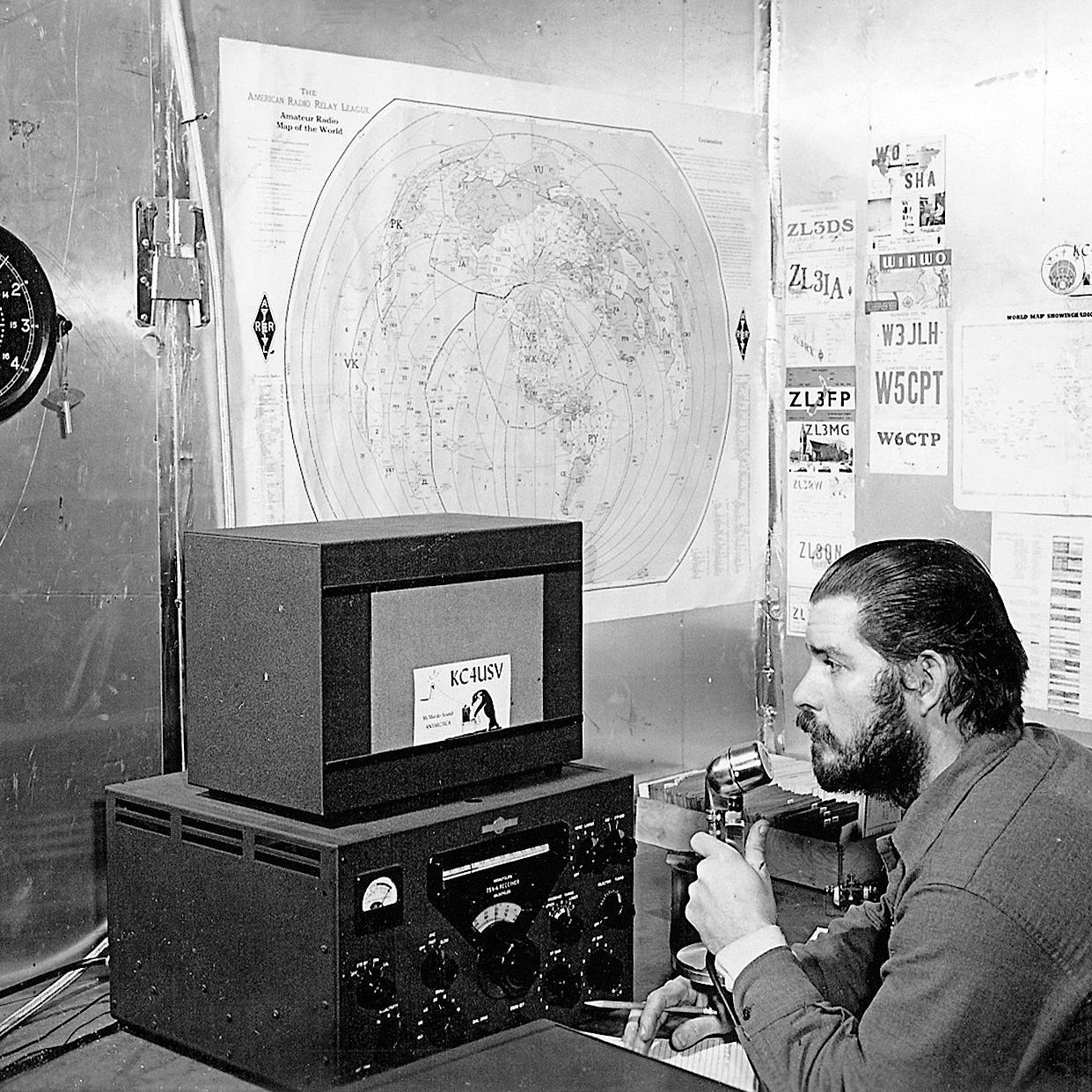 U.S. Navy Chief Petty Officer Adrey Garret uses a ham radio at Williams Air Operating Facility during the 1956 winter. Ham radio was the only means of voice communication with friends and family back in the U.S. for navy personnel living and working in Antarctica in the days before satellite telephone technology became common.
