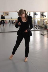 Charlotte preparing to dance.