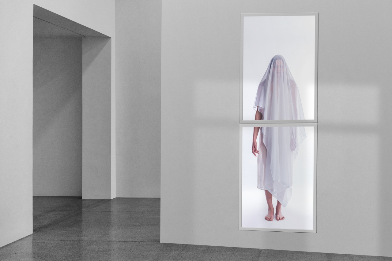 Apparition, installation view (mock-up), Duratrans, glass, acrylic, aluminum, wood, micro-computer, sensor, 2019. (photo: Brian Bixby)